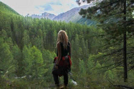Outdoorsy woman on forest mountain