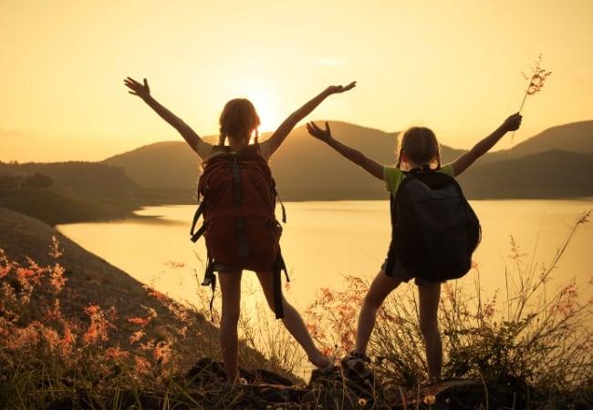 Kids hiking a lake