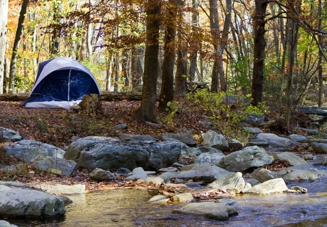 Camping tent at stream
