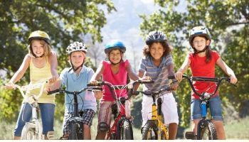 Camping kids riding bikes