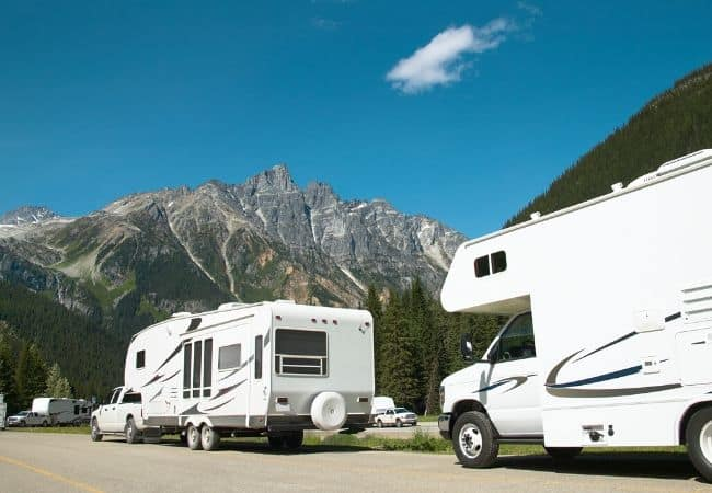 Camper and RV at the mountains. RV tips for beginners