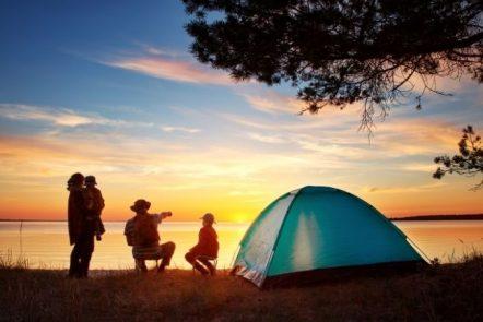 Family tent camping at lake