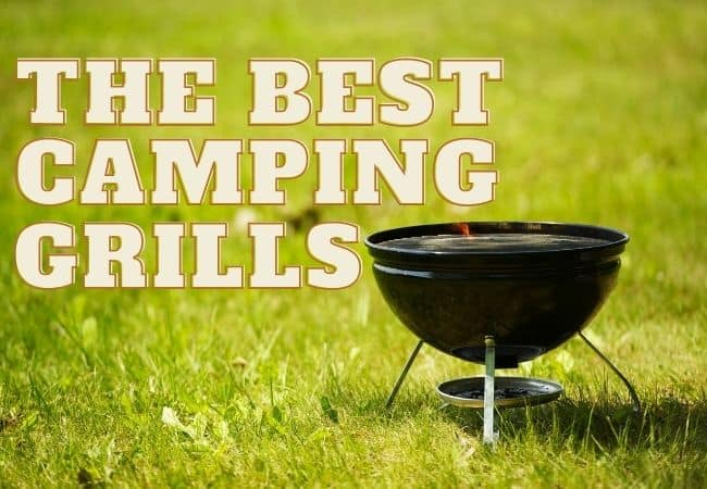 Portable camping grill on green grass